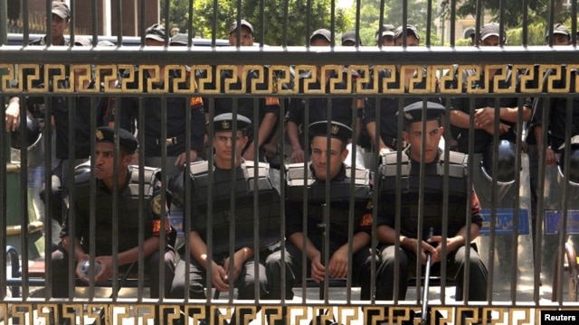 Members of the riot police in front of the parliament building in Cairo, July 10, 2012.
