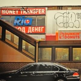 An exhibit photo of a doughnut shop in Brighton Beach, a Russian-speaking neighborhood in New York
