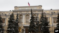 FILE - Russia's Central Bank building in Moscow, Russia, Friday, Jan. 30, 2015. US announced tough new economic measures against Russia Thursday. (AP Photo/Alexander Zemlianichenko)
