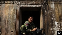 A Cambodian soldier polishes his boots at the 11th-century Preah Vihear temple on the border between Thailand and Cambodia, February 8, 2011