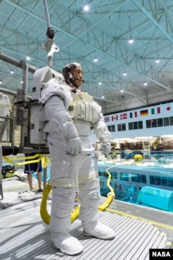 In this November 7, 2018, photo, 2017 astronaut candidate Jonny Kim prepares for underwater spacewalk training at NASA Johnson Space Center's Neutral Buoyancy Laboratory in Houston. Photo Credit: (NASA/Robert Markowitz)