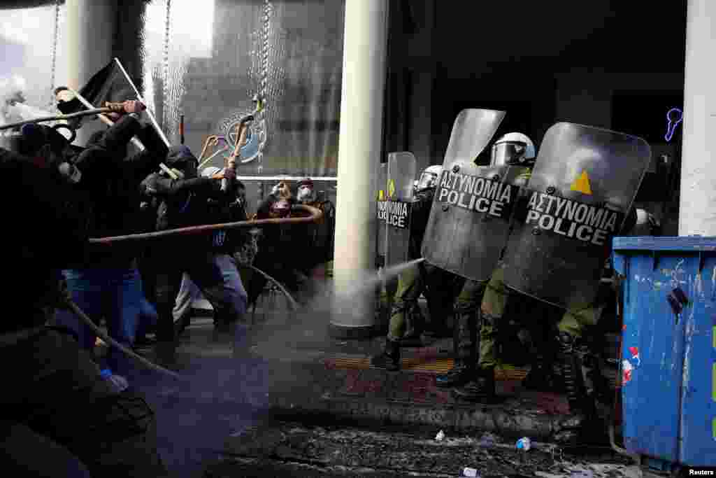 Farmers from the island of Crete clash with riot police during a demonstration outside the Agriculture Ministry in Athens, Greece.