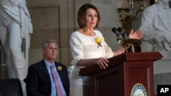 Speaker of the House Nancy Pelosi, D-Calif., and House Republican Leader Kevin McCarthy, D-Calif., left, appear together at an event to commemorate the 100th anniversary of the 19th Amendment in Washington, Tuesday, May 21, 2019.