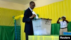 FILE - Rwandan President Paul Kagame casts vote during parliamentary election, Kigali, Sept 16, 2013.