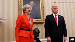 President Donald Trump stands with British Prime Minister Theresa May in the Oval Office of the White House in Washington, Jan. 27, 2017.