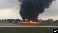 In this image taken from a video smoke billows as a light plane crashed after takeoff from Malta airport, in Valletta, Oct. 24, 2016.