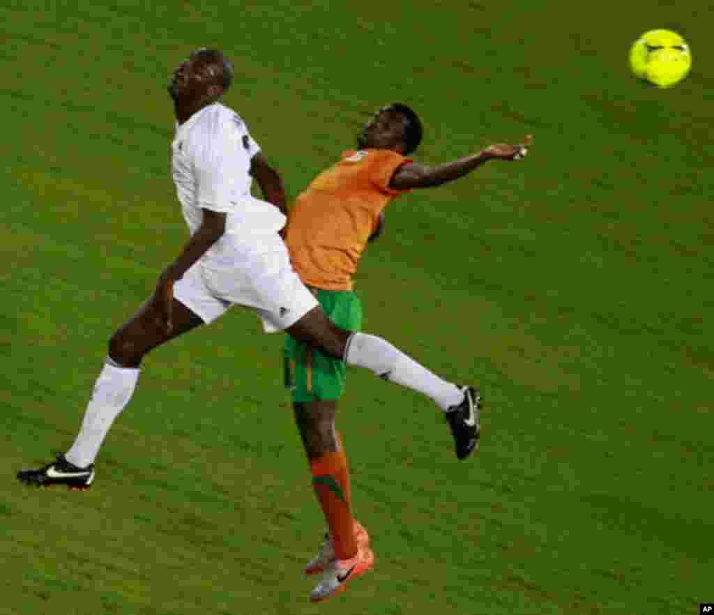 "Francis Kasonde of Zambia challenges Djamal Mahamat of Libya during their African Nations Cup Group A soccer match at Estadio de Bata ""Bata Stadium"", in Bata"