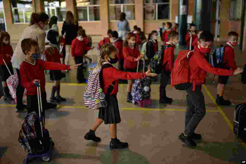 Students wait in a line before entering a classroom, at the Luis Amigo school, in Pamplona, northern Spain, Sept. 7, 2020.