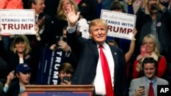 Republican presidential candidate Donald Trump waves during a rally in Biloxi, Mississipi, Jan. 2, 2016. Trump dismissed his appearance on a recruitment video made by the Somali militant group al-Shabab.