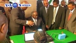 With elections coming in March, Kenyan President Kibaki is first to register on new biometric voter registration machines.