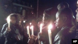 Haitians gather for candlelight vigil in front of Haitian Embassy in Washington DC, 13 Jan 2010