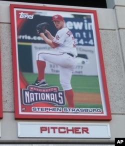 Stephen Strasburg's giant baseball card greets fans entering National Park in Washington