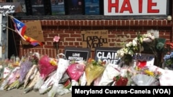 The front of the Stonewall Inn have been covered with flowers, candles and messages in memory of those who were lost in the tragedy.