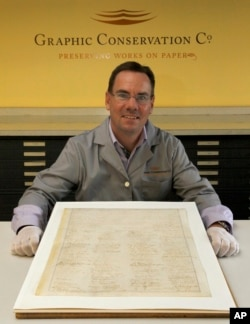Russ Maki, president of Graphic Conservation Company displays a rare copy of the 13th Amendment that ended slavery in this 2011 file photo.