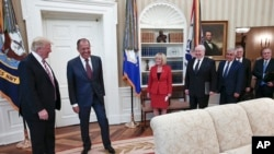 U.S. President Donald Trump meets with Russian Foreign Minister Sergey Lavrov, second left, at the White House in Washington, May 10, 2017. (Russian Foreign Ministry photo via AP)