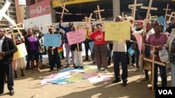 Zimbabweans stage protest over the introduction of the national pledge.
