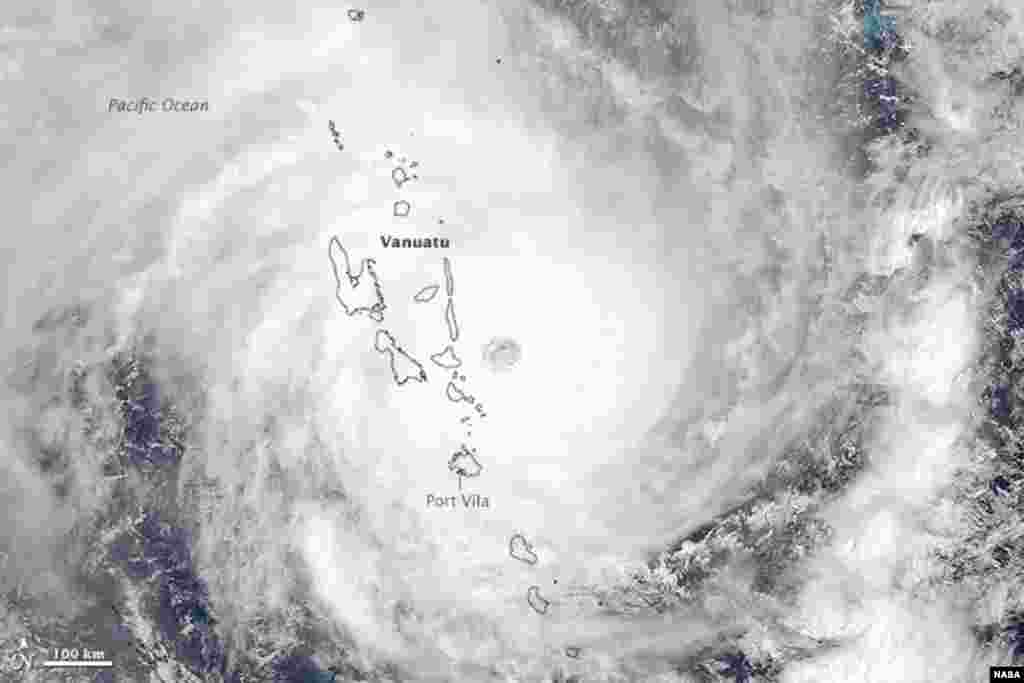 Cyclone Pam was heading in a southwesterly direction when the Moderate Resolution Imaging Spectroradiometer (MODIS) on NASA's Aqua satellite acquired this image at 1:30 p.m. local time (2:20 Universal Time) on March 13, 2015. Not long after the image was acquired, the storm struck the island of Efate, which is home to Vanuatu's capital city, Port Vila.