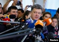 FILE - Ukrainian President Petro Poroshenko talks to reporters.