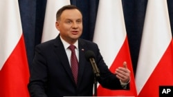 Poland's President Andrzej Duda tells a news conference he has decided to sign two laws that will put courts under more political control even though they are part of a review a concerned European Union is conducting in Warsaw, Poland, Dec. 20, 2017.