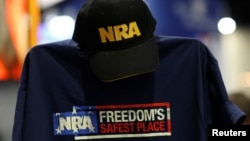 FILE - A cap and shirt are displayed at the booth for the National Rifle Association (NRA) at the Conservative Political Action Conference (CPAC) at National Harbor, Maryland, U.S., Feb. 23, 2018.