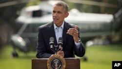 美國總統奧巴馬星期六在白宮草坪出發前往馬莎葡萄園度週末前,就伊拉克問題發表講話。