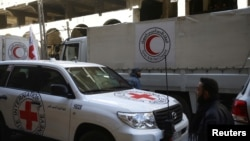 International Red Cross (CIRC) and Red Crescent aid trucks are seen in the besieged town of Douma, eastern Ghouta, in Damascus, Syria, March 9, 2018.