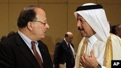 Libyan Finance Minister Nagib Mustafa al-Serraj, left, talks with Yousef Hussain Kamal, Qatar Finance Minister, at the opening of Arab Finance Ministers Exceptional meeting in Abu Dhabi, United Arab Emirates, September 7, 2011.