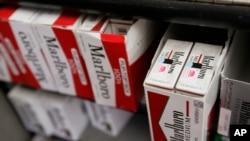 FILE - Cartons of Philip Morris' Marlboro cigarettes are on display at a market in Palo Alto, California, Feb. 2, 2009.