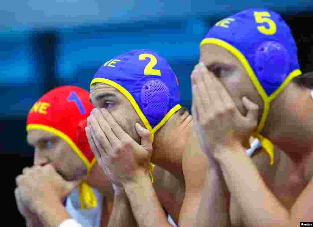 Montenegro's water polo players watch the final seconds of their team's loss to Croatia.
