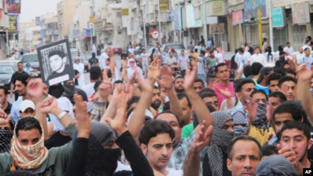 Protesters shout slogans asking for the release of prisoners they say are held without trial, in Saudi Arabia's eastern Gulf coast town of Qatif, March 11, 2011