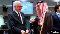Polish Foreign Minister Jacek Czaputowicz and Saudi's Minister of State for Foreign Affairs Adel al-Jubeir attend a joint meeting of European Union and League of Arab States foreign ministers in Brussels, Belgium, Feb. 4, 2019.