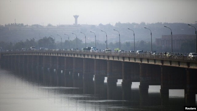 Vehicles cross on a bridge in the Malian capital of Bamako, January 12, 2013.