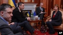 Ukrainian opposition leader Oleg Tjagnibok, left, and Ukrainian lawmaker and chairman of the Ukrainian opposition party Udar (Punch), former WBC heavyweight boxing champion Vitali Klitschko, second left, during their talks with EU foreign policy chief Cat