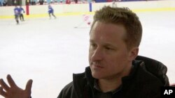FILE - In this image made from video taken on March 11, 2016, entrepreneur Michael Spavor speaks during a friendly hockey match between visiting foreigners and North Korean players in Pyongyang, North Korea.