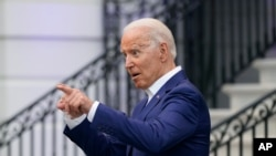 President Joe Biden speaks with an attendee during an Independence Day celebration on the South Lawn of the White House, Sunday, July 4, 2021, in Washington. (AP Photo/Patrick Semansky)