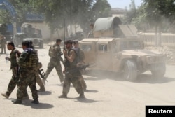 Afghan Commando forces are seen at the site of a battle field where they clash with the Taliban insurgent in Kunduz province, June 22, 2021.