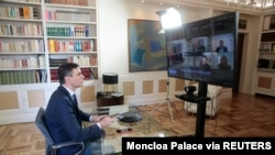 Spanish Prime Minister Pedro Sanchez holds a videoconference with some of his ministers over the coronavirus outbreak, at the Moncloa Palace in Madrid, March 13, 2020.