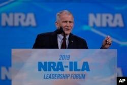 FILE - Nation Rifle Association President Lt. Col. Oliver North (Ret.) speaks at the National Rifle Association Institute for Legislative Action Leadership Forum in Indianapolis, Indiana, April 26, 2019.
