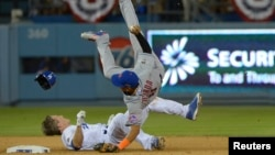FILE - New York Mets shortstop Ruben Tejada suffered a broken leg on this play when Los Angeles Dodgers second baseman Chase Utley rolled toward him to try to break up a double play in a National League playoff game at Dodger Stadium, Oct 10, 2015.