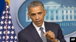 President Barack Obama speaks about the situation in Ukraine in the press briefing room of the White House, July 18, 2014.