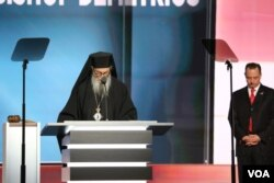 Archbishop Demetrios, of the Greed Orthodox Archdiocese of America, gives the benediction at the end of Wednesday's program of the Republican National Convention, July 20, 2016. Republican National Committee chairman Reince Priebus is at right.