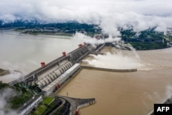 This aerial picture taken on June 29, 2020 shows wbeing ater released from the Three Gorges Dam, a gigantic hydropower project on the Yangtze river, in Yichang, central China's Hubei province.