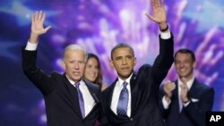 Vice President Joe Biden and President Barack Obama wave at the Democratic National Convention in Charlotte, North Carolina.
