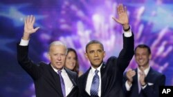 Vice President Joe Biden and President Barack Obama wave to the delegates at the conclusion of Presdident Obama's speech at the Democratic National Convention in Charlotte, N.C., Sept. 6, 2012.