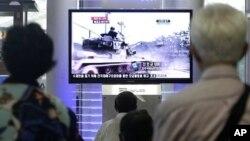 電視新聞顯示南韓坦克以往的演習