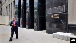 FILE - A man walks out of the Export-Import Bank, July 28, 2015, in Washington D.C.