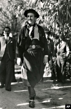 Walt Disney in full gaucho dress at an event hosted by the Cartoonists Association of Argentina.