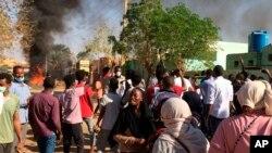 Anti-government protesters rally in Khartoum, Sudan, Sunday, Jan. 13, 2019.