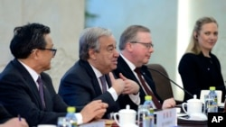 U.N. Secretary-General Antonio Guterres, second from left, talks with Chinese Foreign Minster and State Counselor Wang Yi during their meeting, April 8, 2018 at the Ministry of Foreign Affairs in Beijing, China.