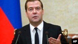 FILE - Russian Prime Minister Dmitry Medvedev during a Cabinet meeting in Moscow, Aug. 7, 2014.